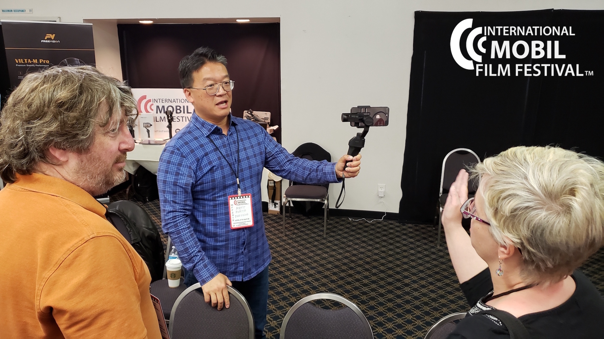 FreeVision Exhibitor Matt Huang gimbal demo with Steve Peterson and Dania Eliot filmmakers.