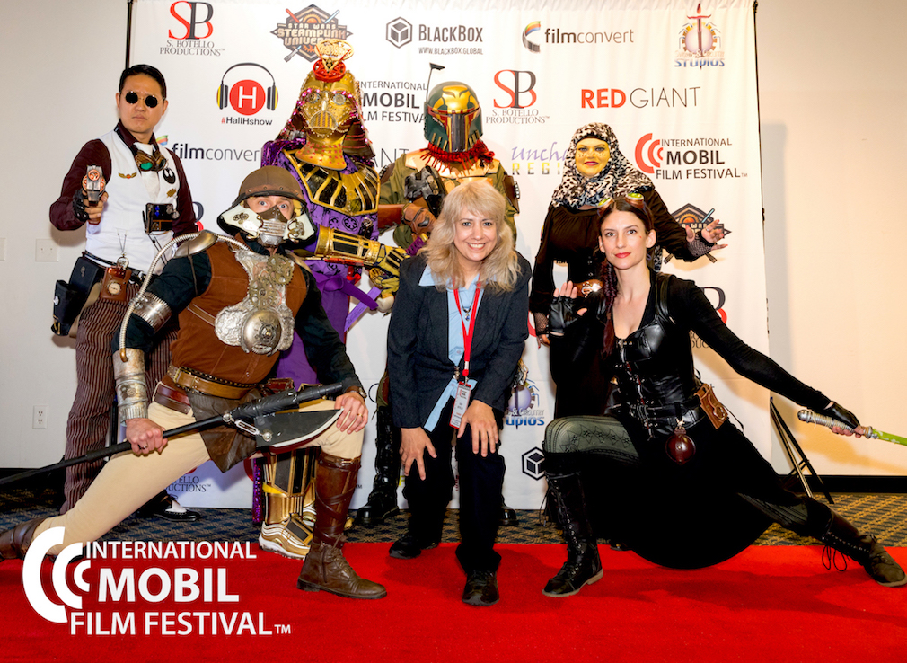 Photo credit: Art Essence Photography. Red Carpet with Star Wars Steampunk Universe group with IMFF founder, Susy Botello (center).